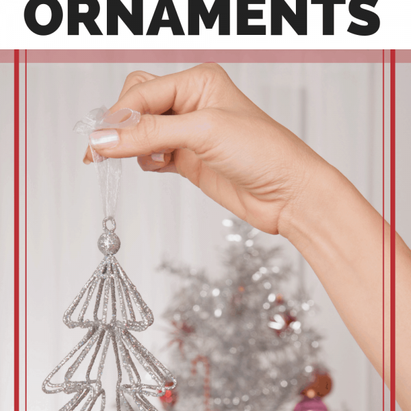 silver Christmas tree ornament in woman's hand