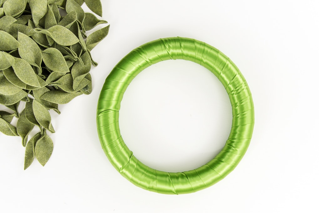 green ribbon wrapped wreath form