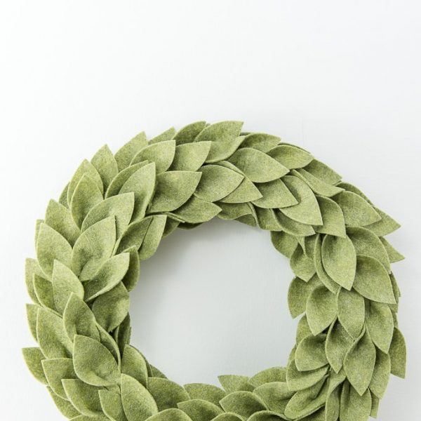 olive green felt greenery wreath on table Christmas
