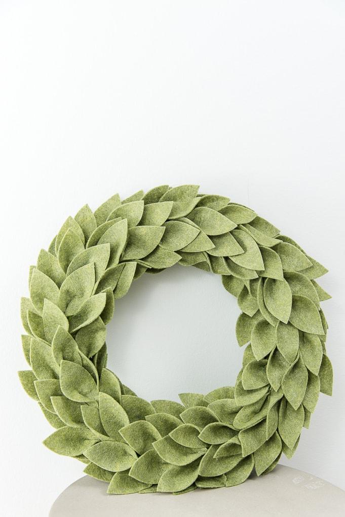 olive green felt greenery wreath on table Christmas