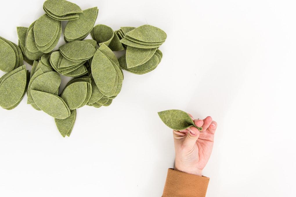 pinching green felt leaves to make them 3D