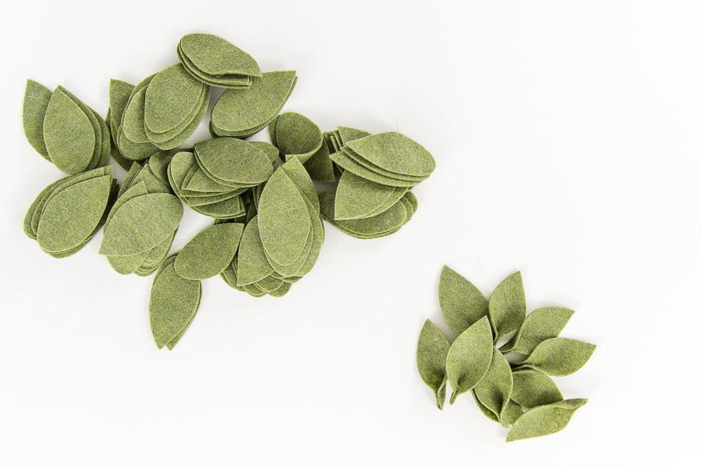assembling green felt leaves pile