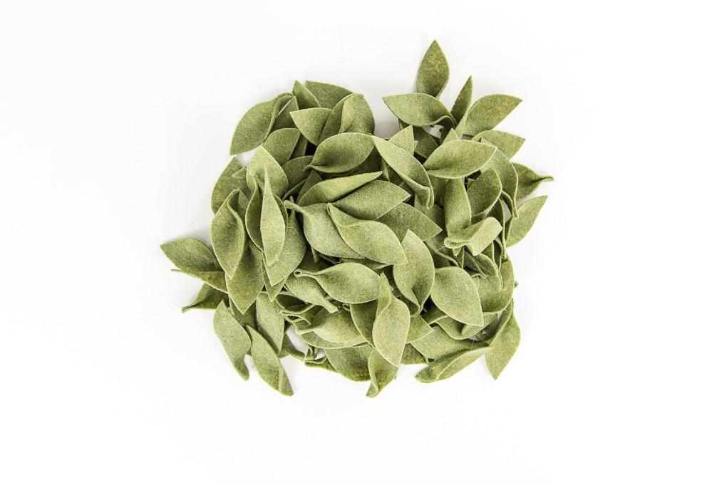 pile of 3D green felt leaves