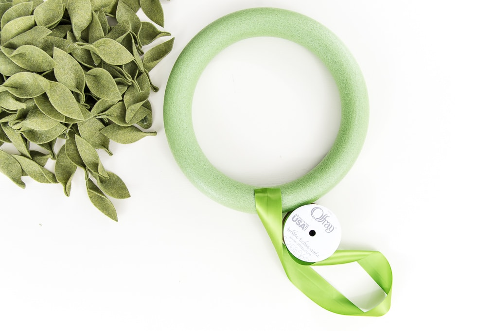 green ribbon on a green wreath form