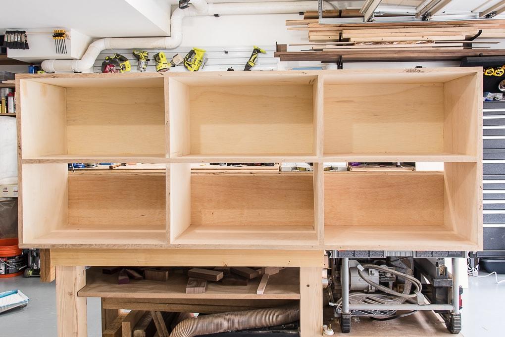 bare diy bookshelves in a workshop