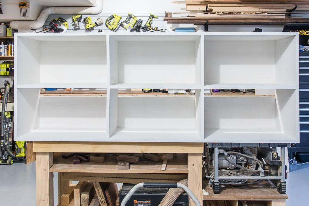 primed diy bookshelves in a workshop