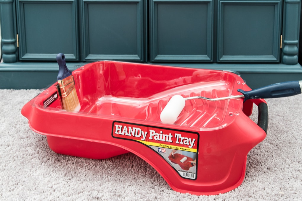handy paint tray with paint brush and paint roller