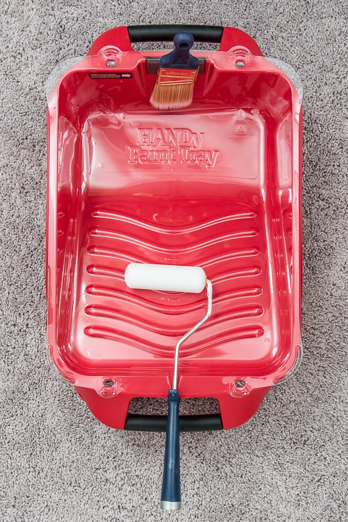 handy paint tray from the top with paintbrush and roller