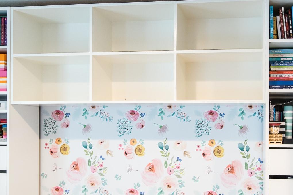 installed white diy bookshelves in a built-in desk close up