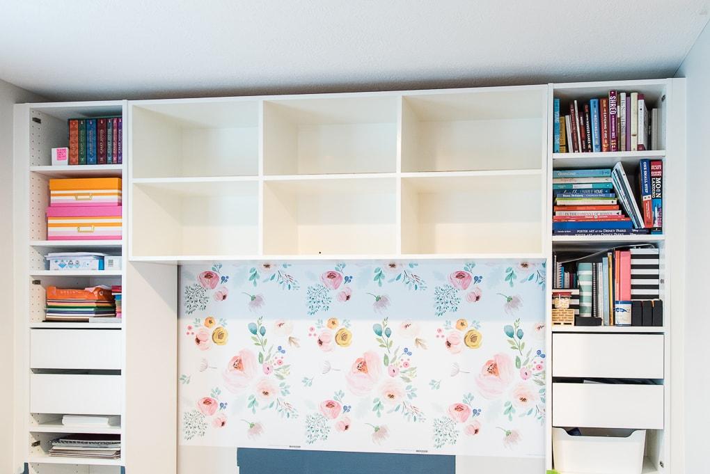 installed white diy bookshelves in a built-in desk