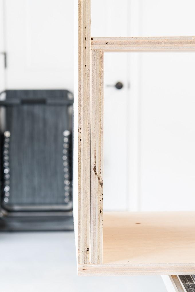 close up of finishing plywood bookshelves