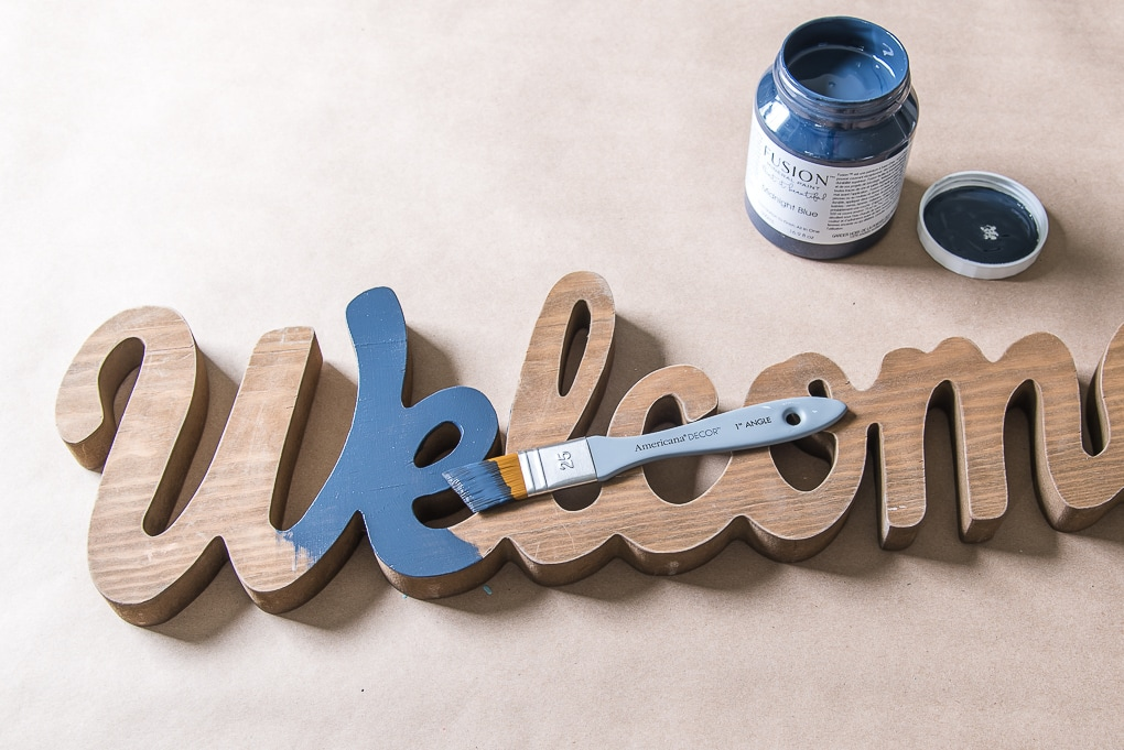 starting to paint with paintbrush welcome sign fusion mineral paint midnight blue