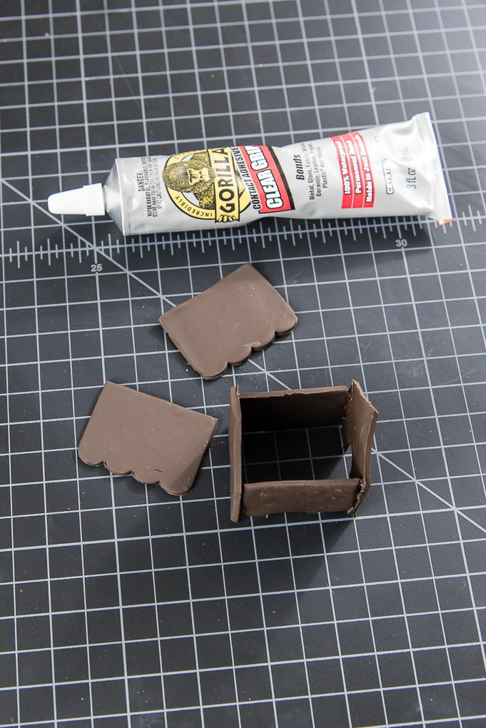 assembling a mini gingerbread house using gorilla glue clear grip