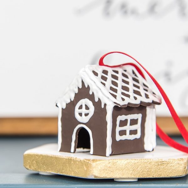 diy mini gingerbread house Christmas ornament on table with red ribbon