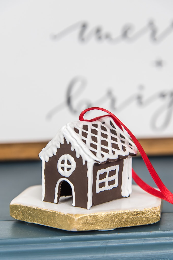 diy mini gingerbread house Christmas ornament with red ribbon on table