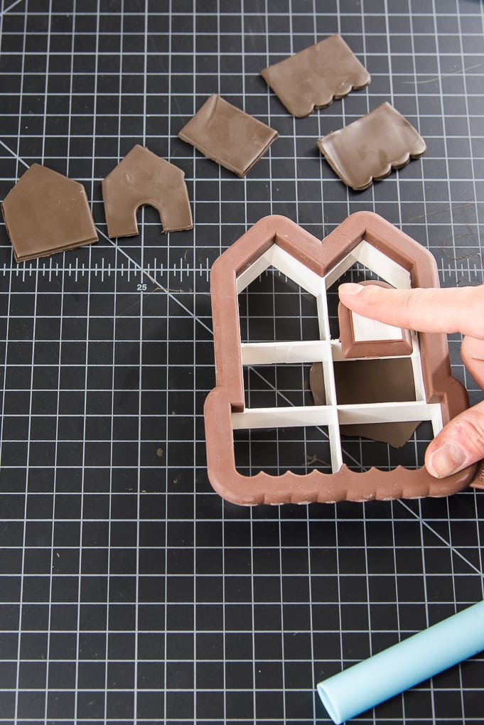 mini gingerbread house cookie cutter and brown clay
