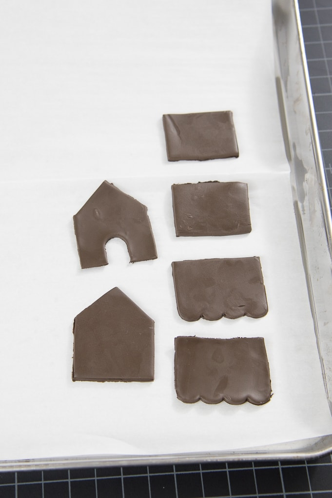 mini gingerbread house walls made out of clay on baking sheet