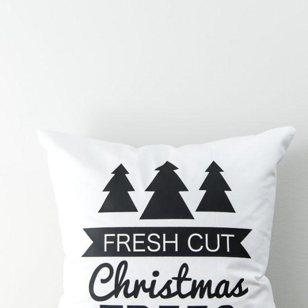 modern white pillow with black iron-on Christmas trees design