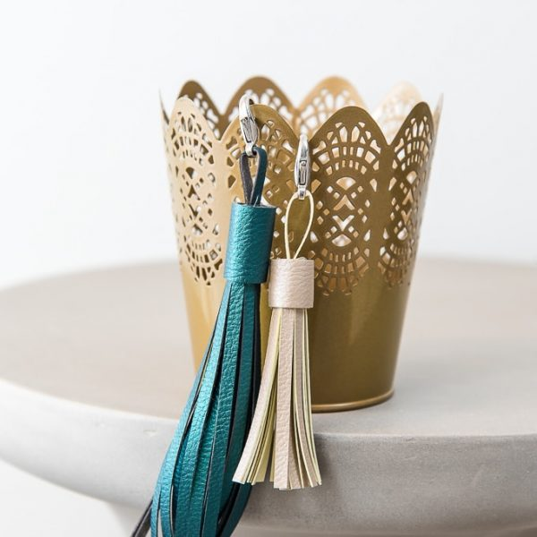 faux leather tassel keychains in teal and tan