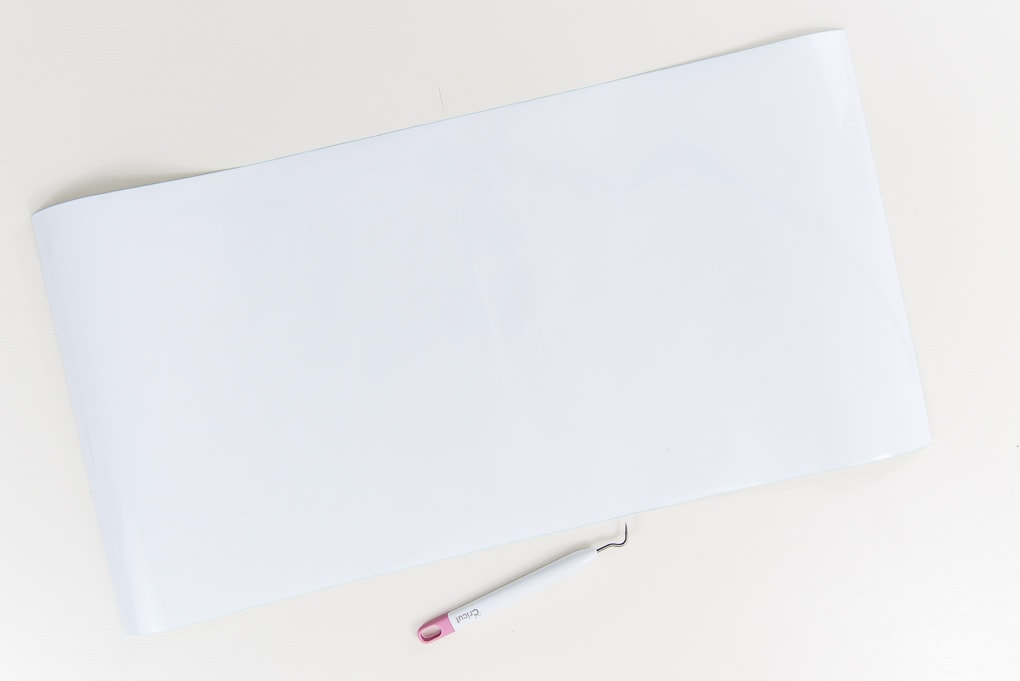 white vinyl with Cricut weeder tool