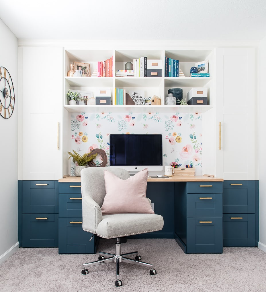 home office built-in desk with chair and pink pillow