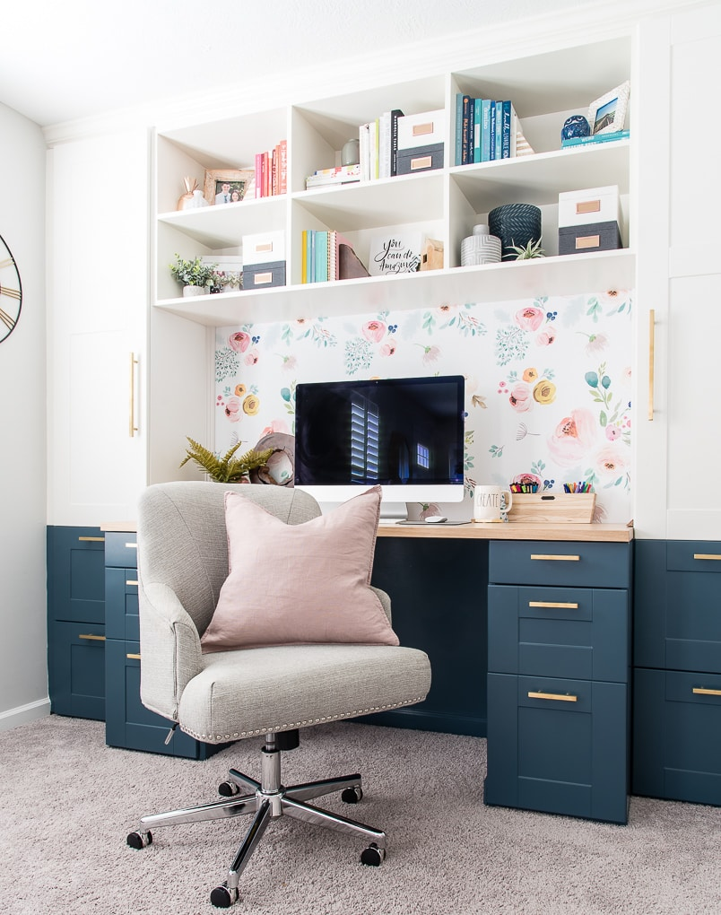 office IKEA SEKCTION cabinets built-in desk with chair and pink pillow
