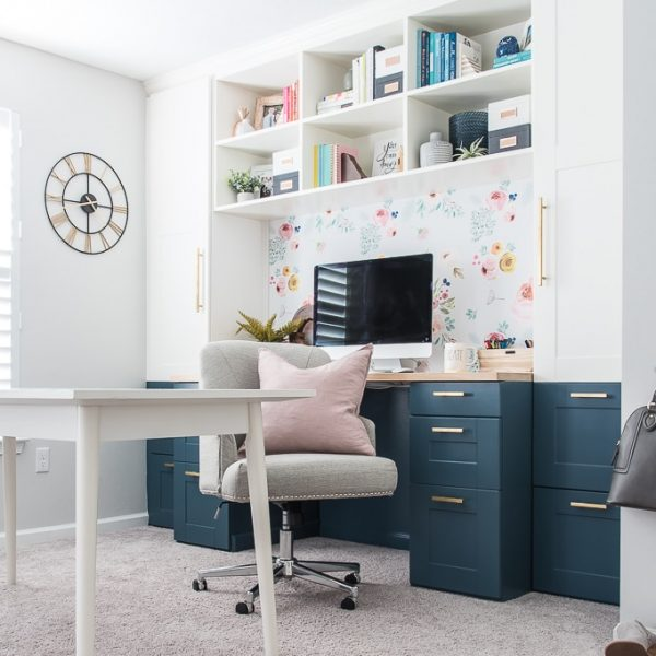 home office built-in desk IKEA SEKTION cabinets chair pink pillow