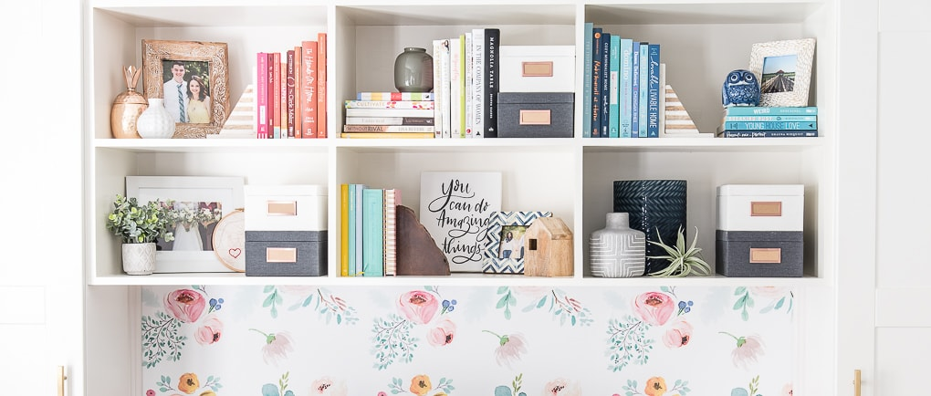 styled diy bookshelves with colorful books and picture frames