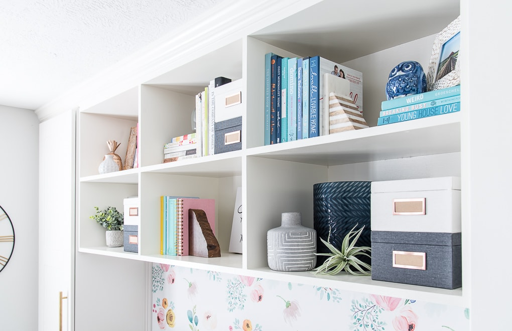 styled bookshelves with colorful accent pieces