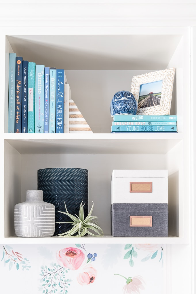 styled bookshelves with blue and gray accent pieces