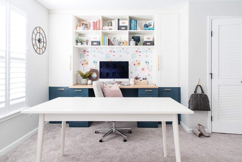white craft table in home office craft room built-in desk and bookshelves