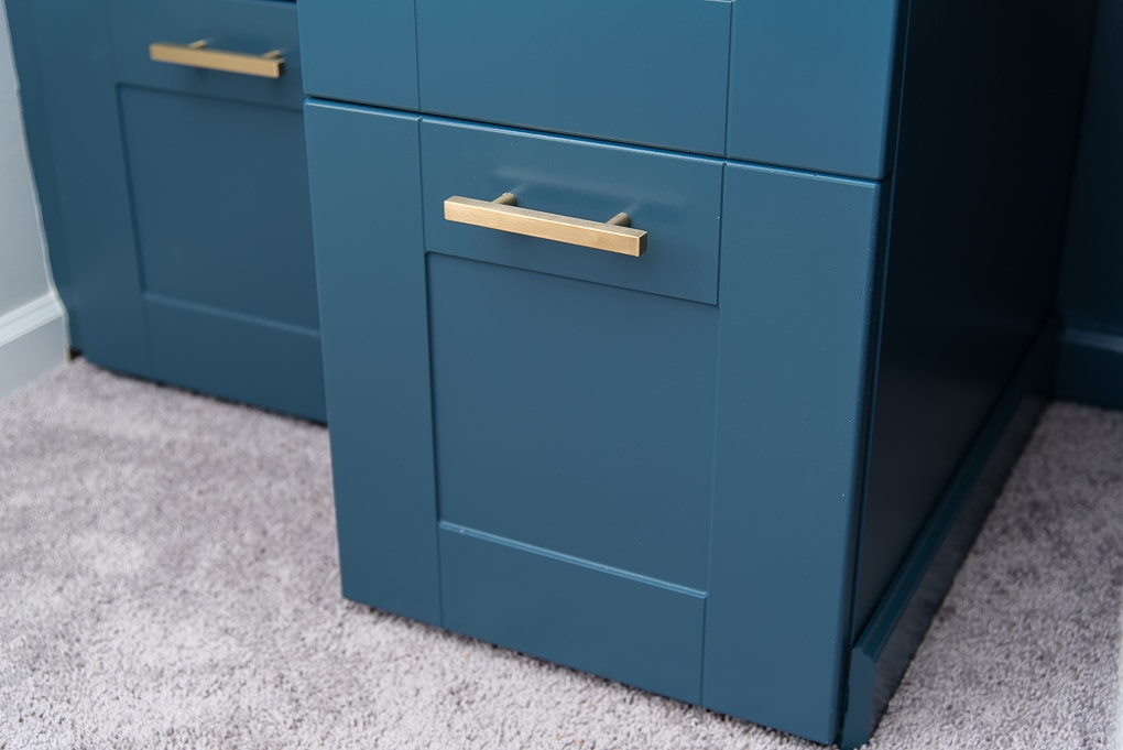 close up of navy IKEA SEKTION cabinets with gold hardware