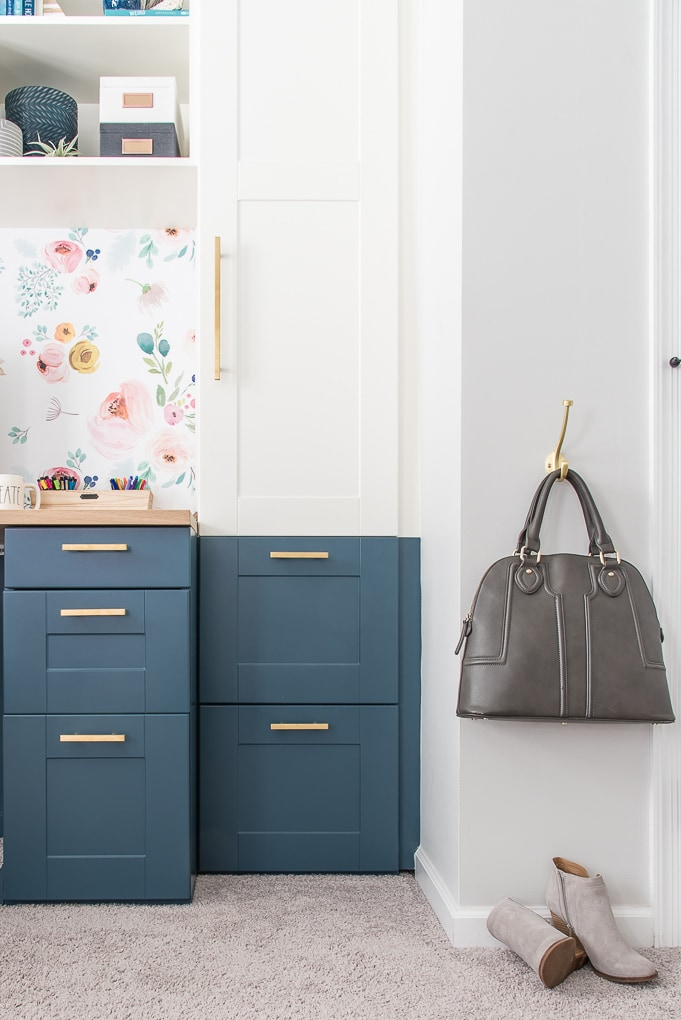 built-in desk navy and white with hanging purse and shoes