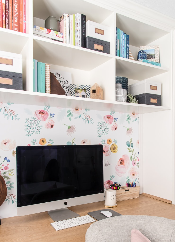 imac desktop computer on desk with floral background