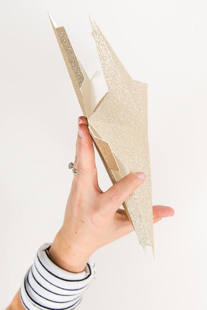 hand holding both side of 3d gold glitter star