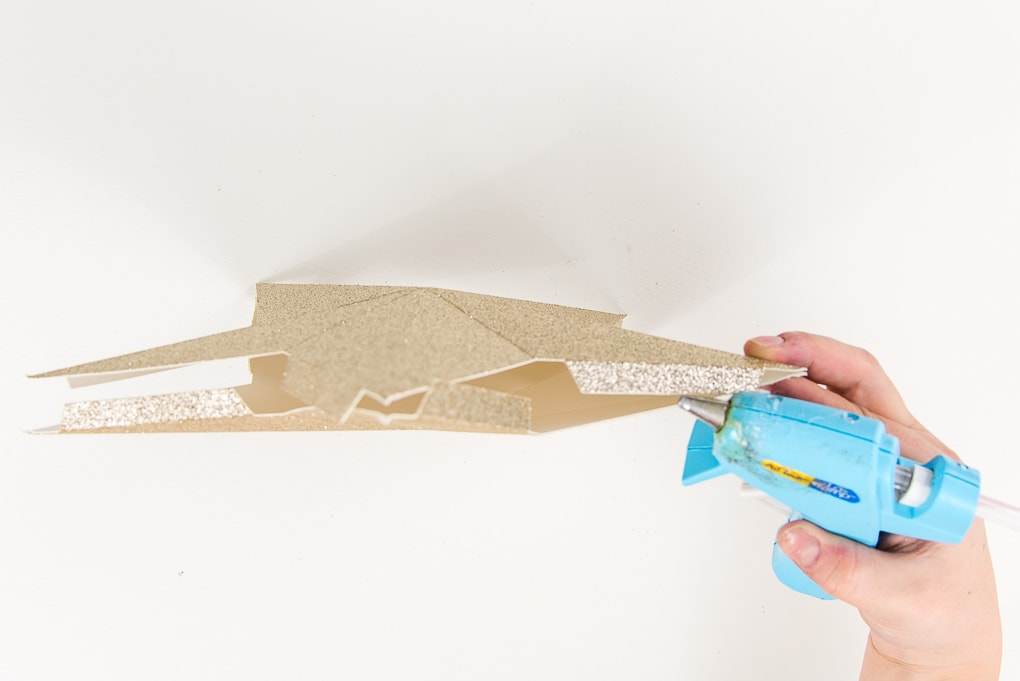 hot glue gun assembling 3D star gold glitter
