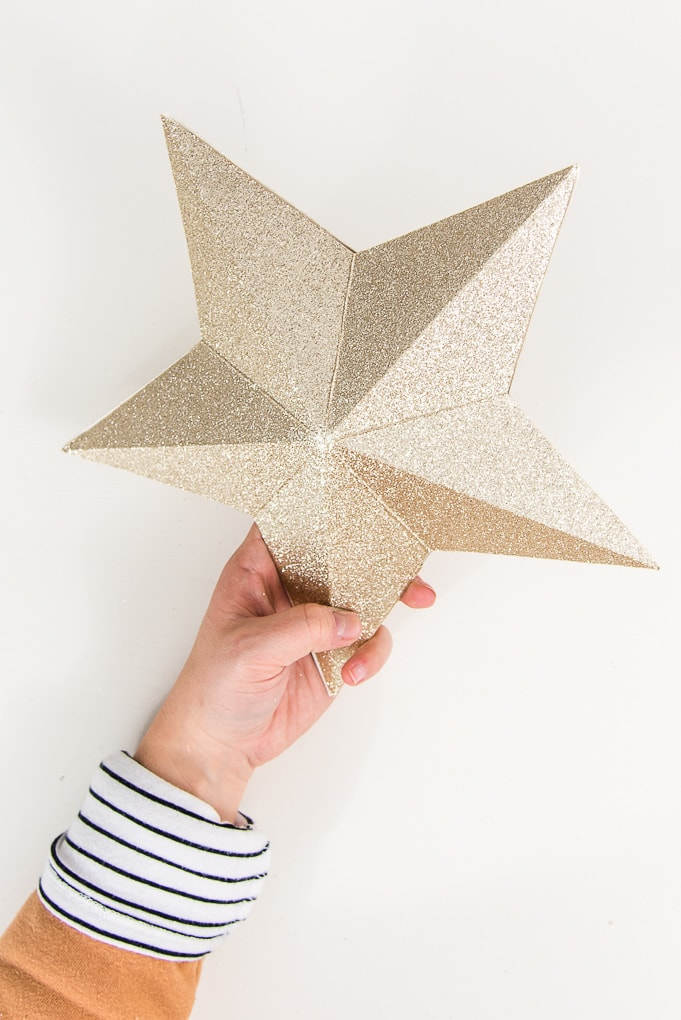 gold glitter 3D star decoration with hand