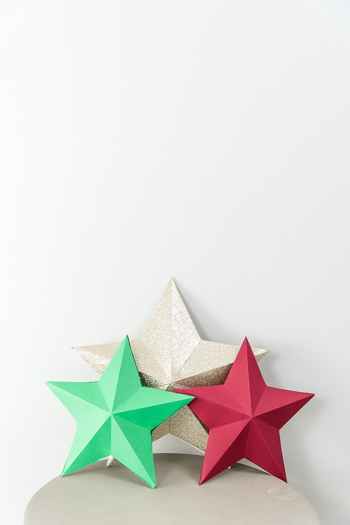 3D star decorations for Christmas red, green, and gold glitter