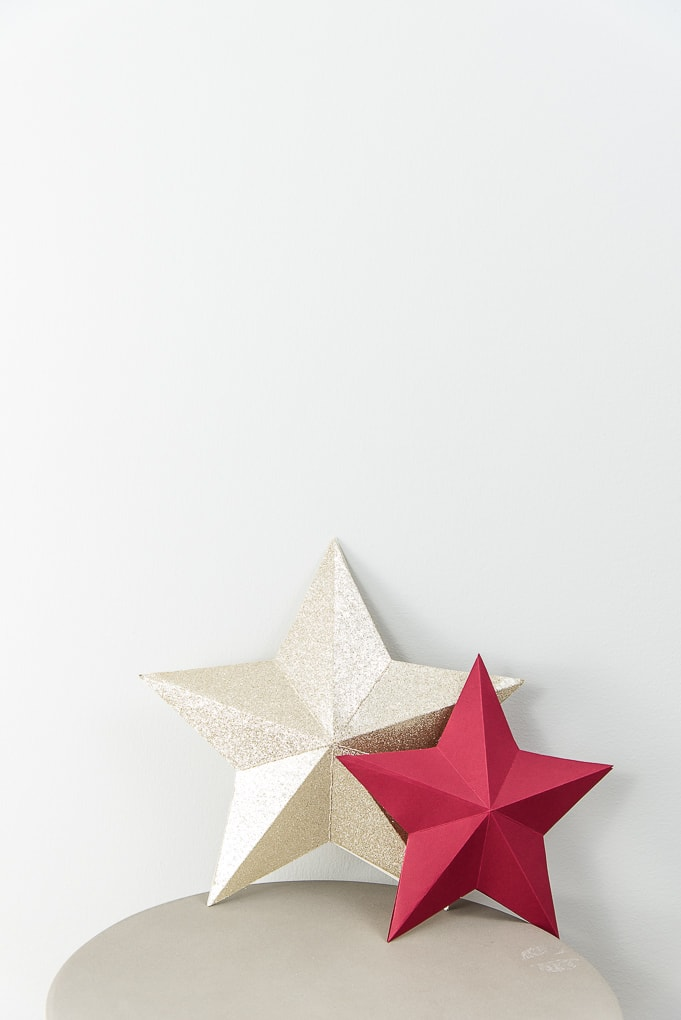 3D star decorations for Christmas red and gold glitter on table