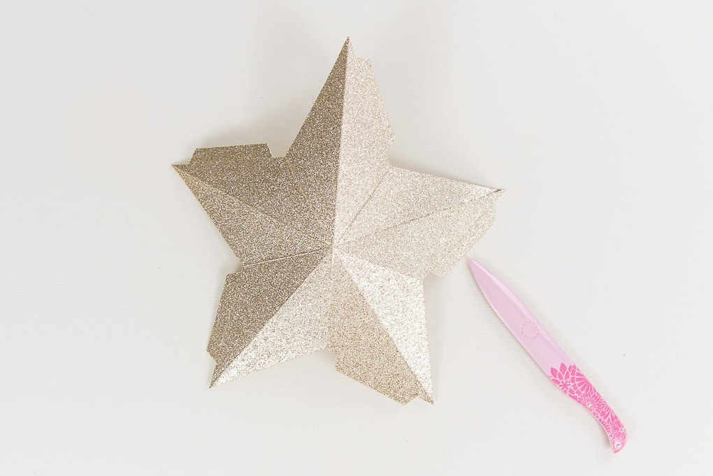 gold glitter star being folded