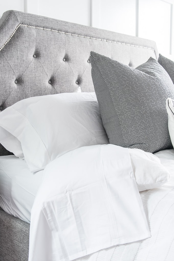 white sheets on a gray bed master bedroom