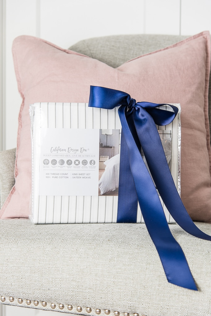 California Design Den white and gray striped sheets with a navy blue bow
