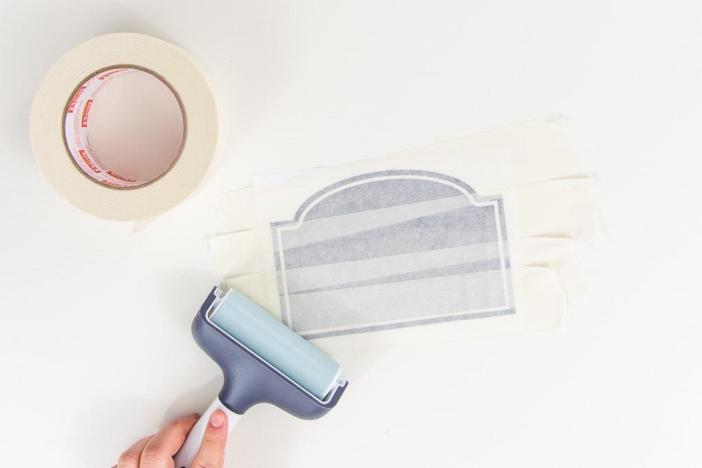 brayer tool on chalkboard vinyl label on transfer tape