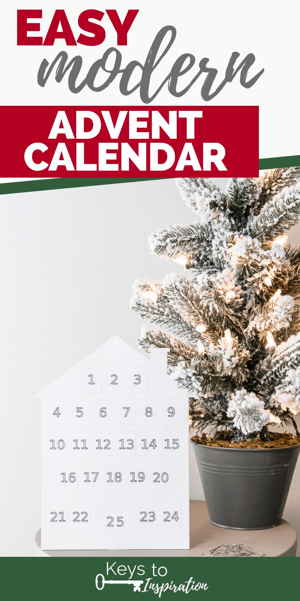 white modern house advent calendar next to a flocked christmas tree