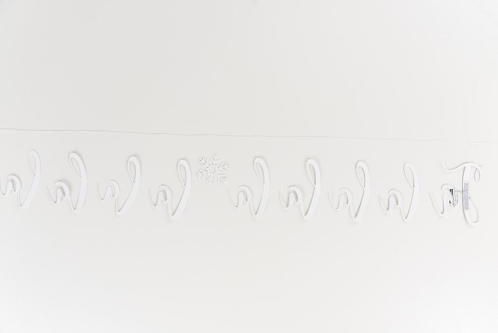 fa-la-la banner letters backward with string above