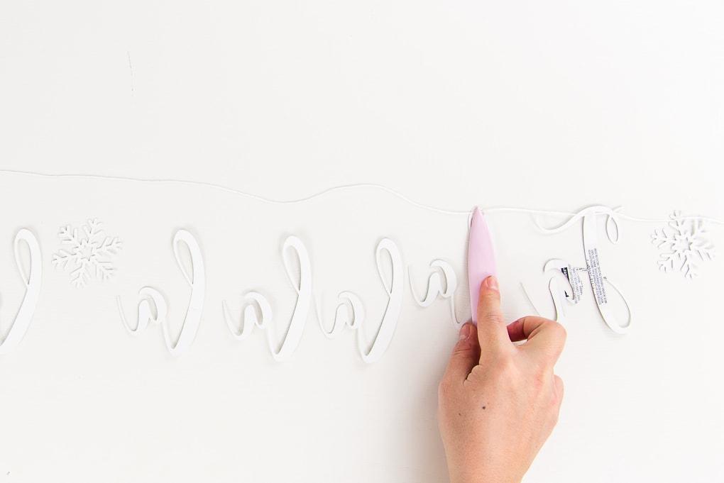 assembling fa-la-la banner letters using bone folder