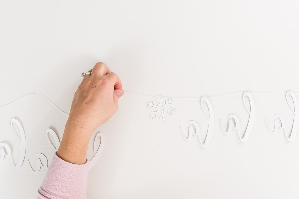 guiding string for fa-la-la banner