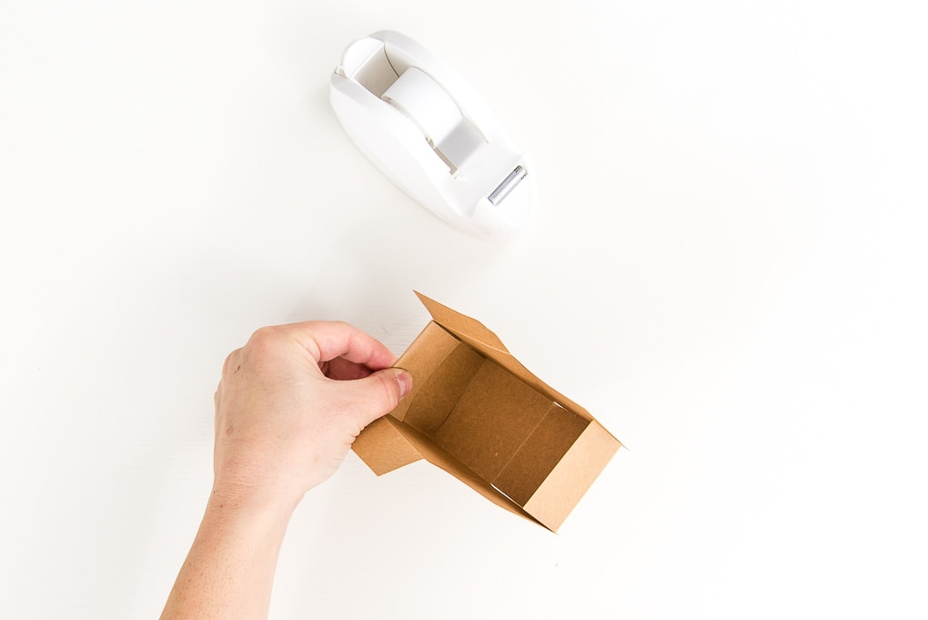 brown 3D paper box and clear tape