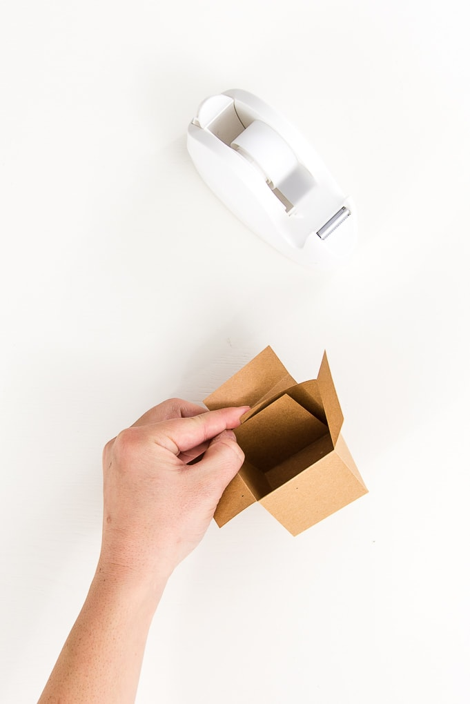 folding brown 3d paper box base by hand