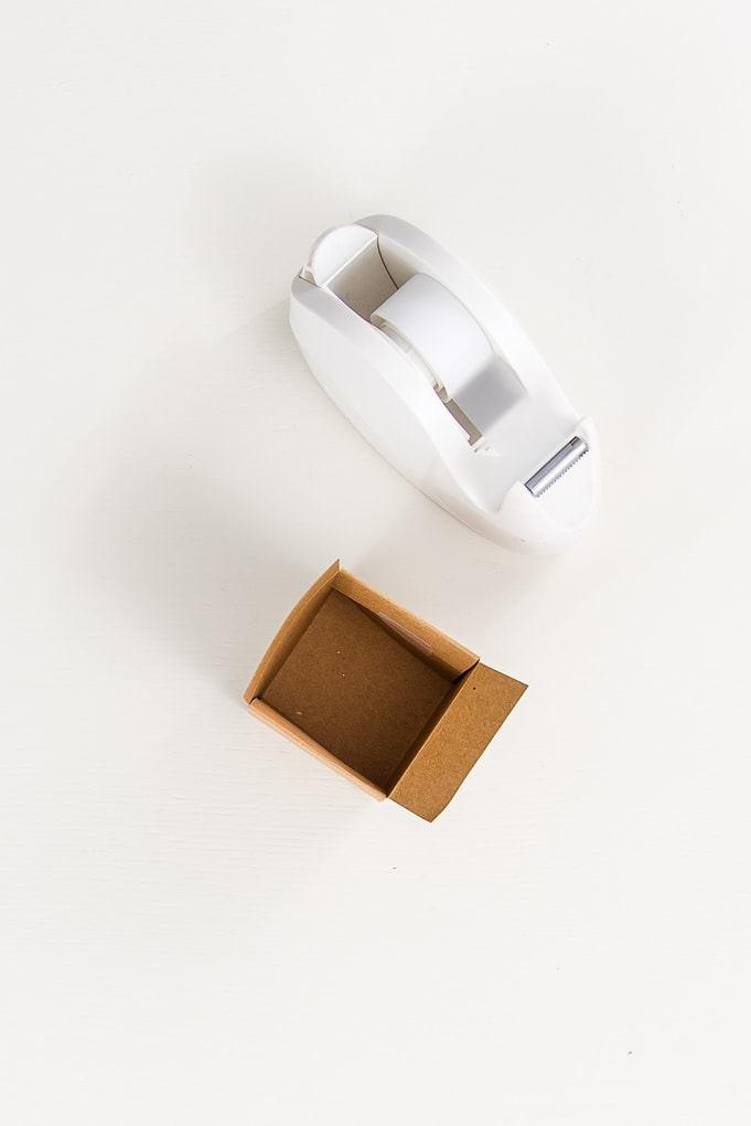 brown 3D paper box and tape dispenser